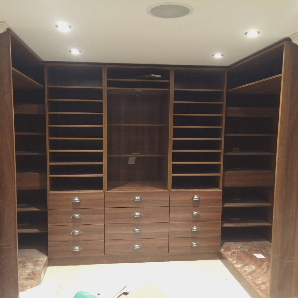 Part of a large walk-in wardrobe in Egger H3704 Tobacco Aida Walnut