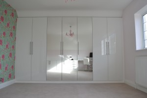 High gloss floor to ceiling cabinet with mirrors